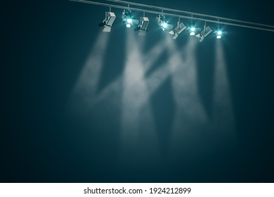 Black spotlights on rail with beams of light in the smoke. 3D rendering