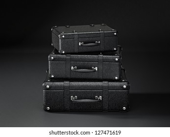 black suitcase isolated on a black background