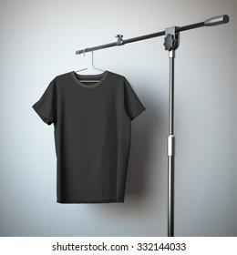 Black t-shirt hanging on the tripod
