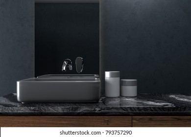 Black wall bathroom interior with a wooden shelf with a black angular sink on it and a narrow vertical mirror. 3d rendering mock up