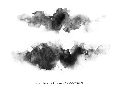 Black watercolor stains on a white background. Abstract painting, naive art. Splashes of ink.