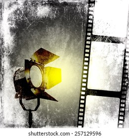 Black and white background with film strip and reflector
