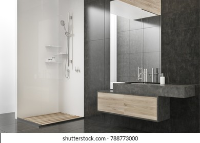 Black and white bathroom corner with a tiled floor, a shower and a sink with a large mirror. 3d rendering mock up