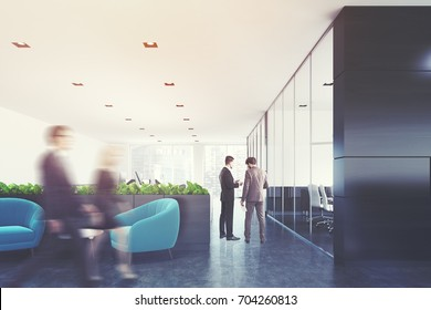 Black and white company office with plants, a glass wall conference room and a waiting area with blue armchairs and a coffee table. People. 3d rendering toned image