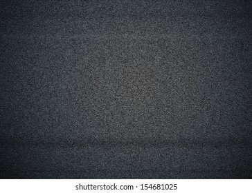 Black and white noise on a TV screen with no signal, also called TV snow.