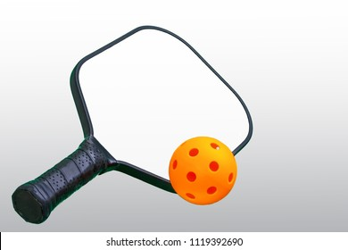 Black and white Pickleball Paddle with Orange ball.
