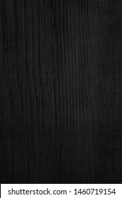 Black wood texture background with natural pattern