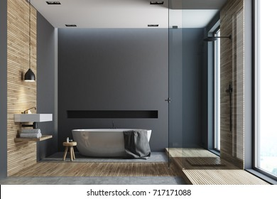 Black and wooden bathroom interior with a wooden floor, tall windows, a round white tub, an angular sink and a glass shower corner. 3d rendering mock up