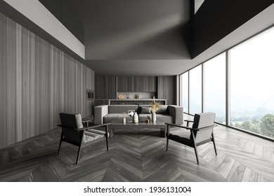 Black wooden interior of kitchen with shelf and kitchenware, grey sofa and armchairs with coffee table. Windows with nature view and parquet floor, 3D rendering no people