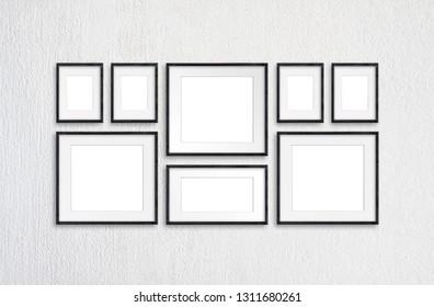 Black wooden realistic photo frames mockup, eight frameworks collage on white plastered wall, 3d illustration