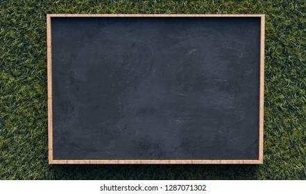 Blackboard on gras background (3D Rendering)