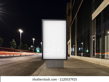 Blank banner on a night street in the city next to the road. 3d rendering