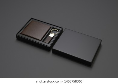 Blank Bi fold Flip Style Leather Wallet With Key Chain packaging Box For Branding. 3d render illustration.