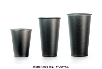 Blank black disposable paper cup mock ups isplated, large, medium and smal, 3d rendering. Empty polystyrene coffee drinking mug mockup front view. Clear plain tea take away plastic package