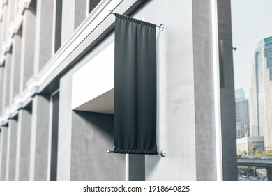 Blank black fabric signboard in front of entrance to modern business center. Mockup. 3D rendering