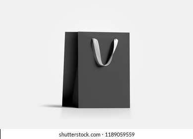 Blank black paper gift bag with white silk handle mockup, 3d rendering. Empty craft carry packet mock up, isolated. Clean shop bagful, side view. Beautiful package for present and shopping
