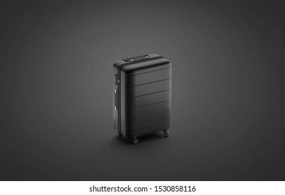 Blank black suitcase mock up stand isolated on darkness background, 3d rendering. Empty carpetbag with closed hanlde mockup, side view. Clear dark baul for airplane or train tourism mokcup template.