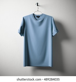 Blank Blue Cotton Tshirt Hanging Center Concrete White Empty Background.Mockup Highly Detailed Texture Materials.Clear Label Space for Business Message. Square. 3D rendering