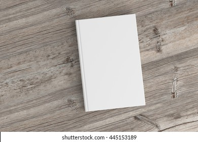 Blank book cover on wooden background. Isolated with clipping path. 3d render