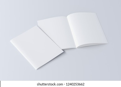 Blank booklet on white background with clipping path around booklets. Open and closed.  3d illustration