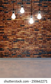 Blank brick wall with place for text illuminated by lamps above,3d render