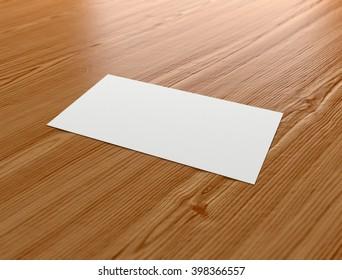 Blank business card on a desk.