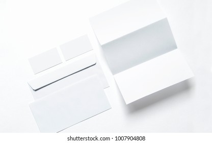 Blank business cards, letterheads and envelopes isolated on white. Clean 3d illustration to showcase your presentation.