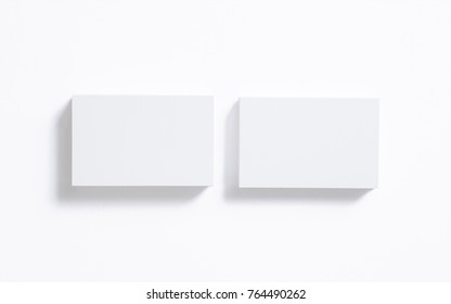 Blank business cards stack isolated on white. Clear 3d render to showcase your presentation.