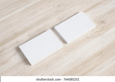 Blank business cards stack on wooden desk. 3d render.