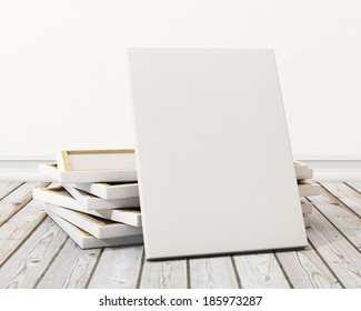 blank canvas or poster with pile of canvas on floor and wall, background