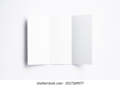 Blank closed Tri fold brochure isolated on white. 3d illustration for your design presentation.