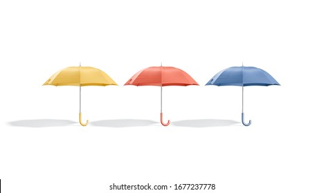 Blank colored opened umbrella mockup stand, front view, 3d rendering. Empty yellow, red and blue parasol with handle mock up, isolated. Clear autumn accessory hand-held mokcup template.