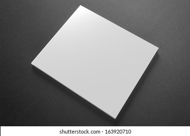 Blank compact disk cover on dark background