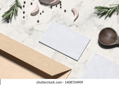 Blank envelope and business card near wooden spoon and flavorings. 3D rendering.