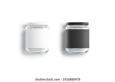 Blank glass jar with black and white label mockup lying, 3d rendering. Empty conservation transparent tin mock up, isolated, top view. Clear screw bank for canned food template.