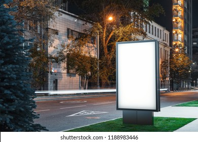 Blank illuminated white outdoor banner stand at night time in the city, 3d rendering.