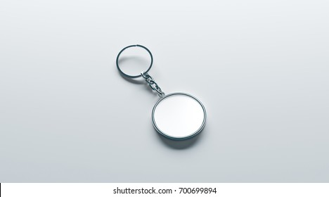 Blank metal round white key chain mock up isometric view, 3d rendering. Clear silver circular keychain design mockup isolated. Empty plain keyring souvenir holder template. Steel circle trinket label