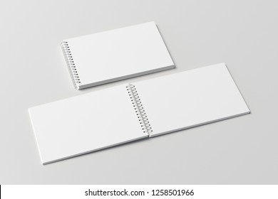 Blank open and closed horizontal spiral notepads on white background. With clipping path around notebooks pages. 3d illustration