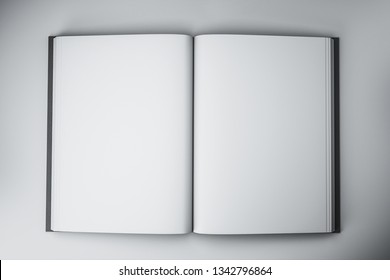 Blank open white hardcover book on concrete desktop background. Mock up, 3D Rendering