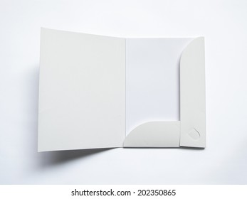 Blank opened folder with document isolated on white