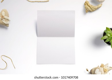 Blank opened invitation, greeting cards isolated on white to  showcase your event presentation. 3d illustration with decoration objects.