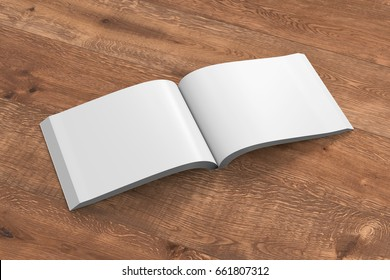 Blank pages of open landscape soft cover book with glossy paper. Isolated  on wooden background with clipping path around book. 3d illustration.