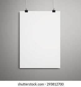 Blank paper poster on gray wall