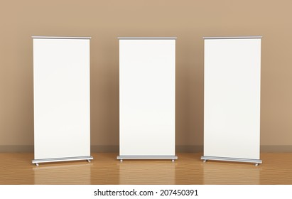 Blank roll-up banners against the brown wall