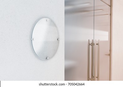 Blank round transparent glass sign plate mockup, 3d rendering. Circular nameplate mock up on the wall near office entrance interior. Signage panel, store door template. Printing board for branding.