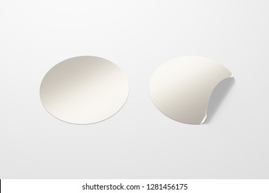 Blank silver round stickers straightened and with folded corner on white background. With clipping path around stickers. 3d illustration.