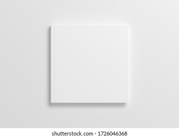 Blank square book cover mock up on white background. View directly above. 3d illustration