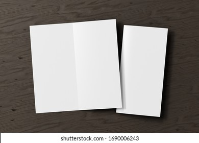 Blank square leaflet on black wooden background. Bi-fold or half-fold opened and folded brochure isolated with clipping path. View directly above. 3d illustration