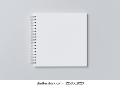 Blank square spiral notepad on white background. With clipping path around notebook pages. 3d illustration