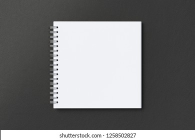 Blank square spiral notepad on black background. With clipping path around notebook pages. 3d illustration